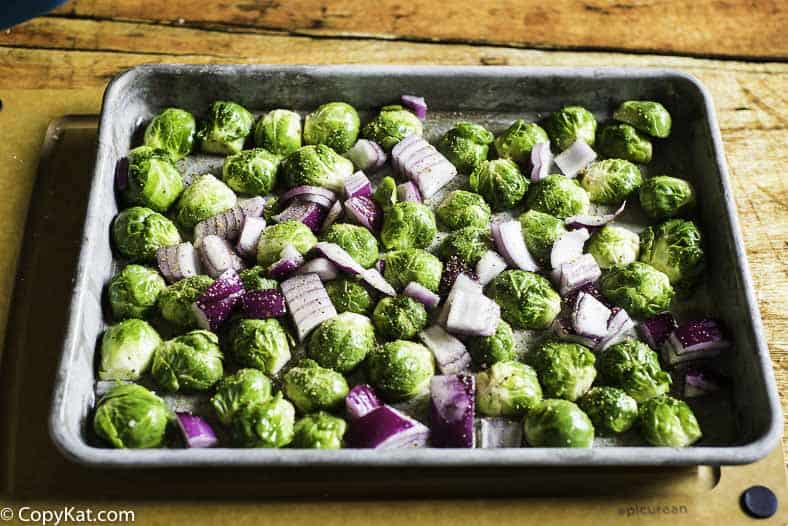 placing cut Brussel Sprouts on the sheet pan before baking them