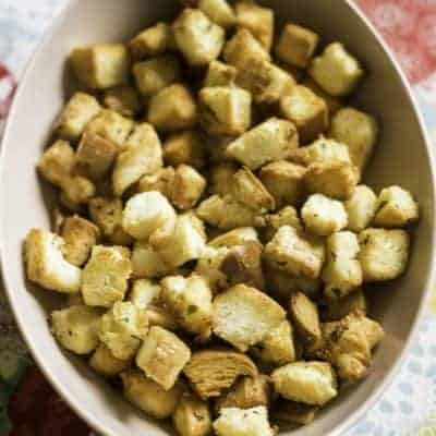 a bowl of homemade crispy buttery croutons