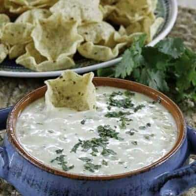 homemade white queso served with crispy chips