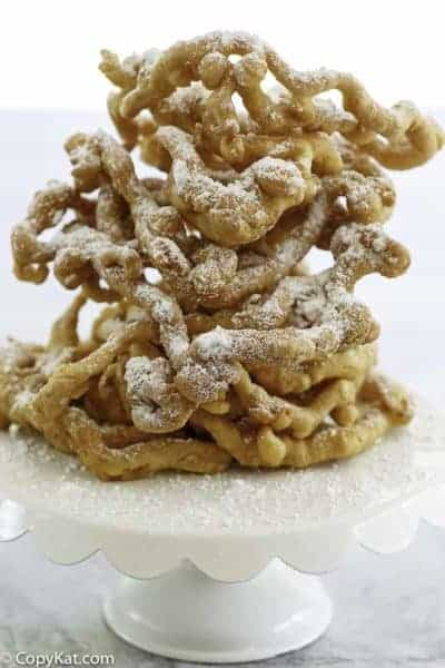 Homemade funnel cakes dusted with powder sugar.