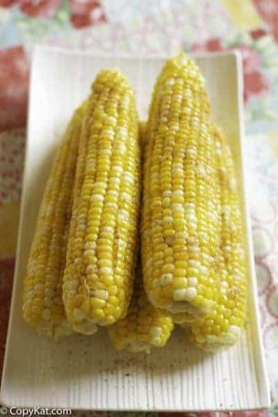 Homemade Red Lobster Chesapeake Corn on the Cob on a serving platter.