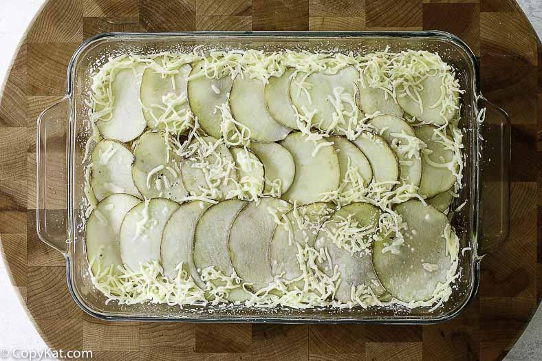 layering potatoes in the pan
