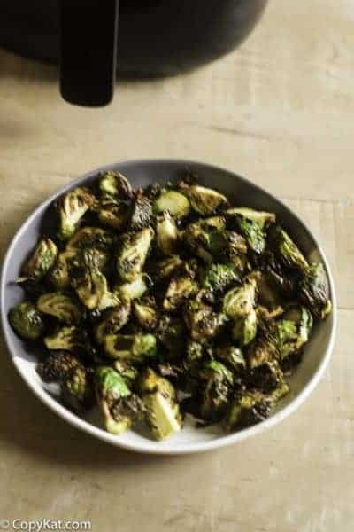 a plate of brussel sprouts with a balsamic vinegar glaze