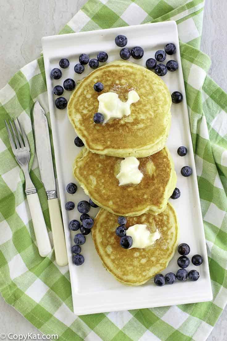 buttermilk pancakes with butter and fresh blueberries