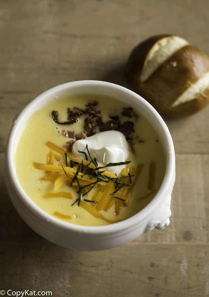 baked potato soup served with a pretzel roll