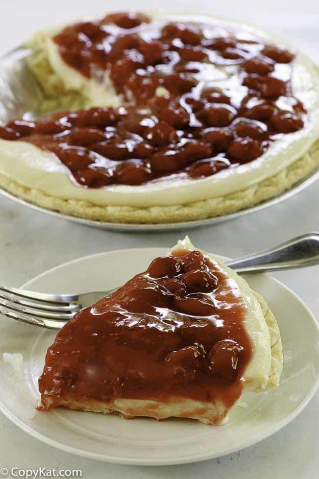 cherry cream cheese pie slice with pie behind it