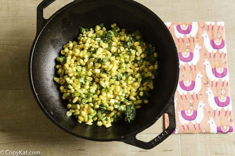 a bowl of fresh corn salsa