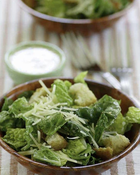 Homemade copycat Outback Steakhouse caesar salad served with homemade caesar salad dressing