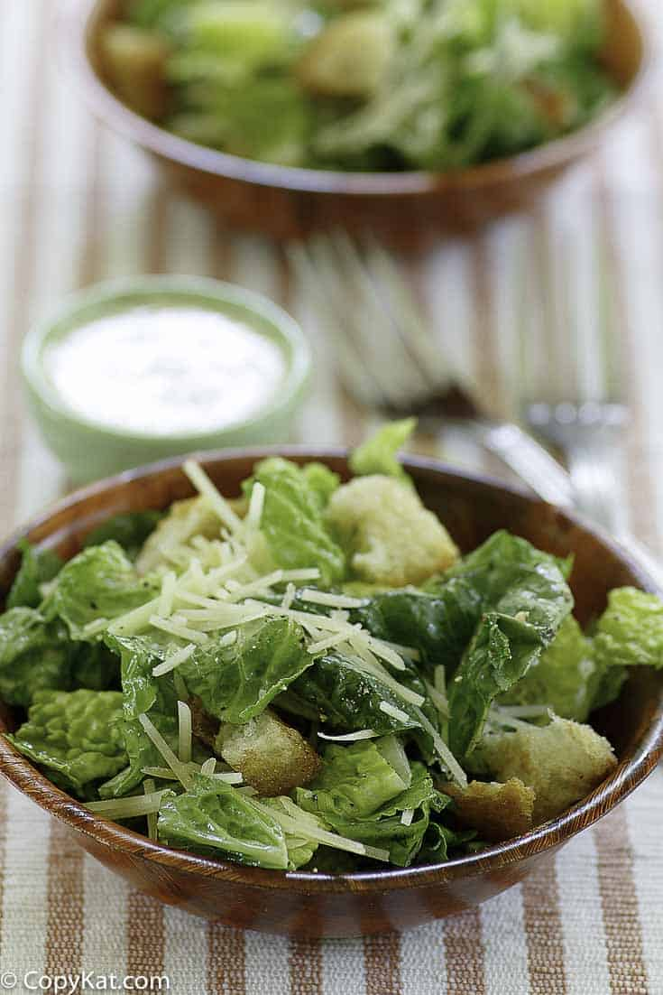 Homemade copycat Outback Steakhouse caesar salad served with homemade caesar salad dressing