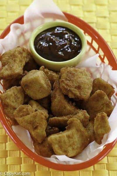 Homemade copycat Chick Fil A chicken nuggets in a basket with barbecue sauce