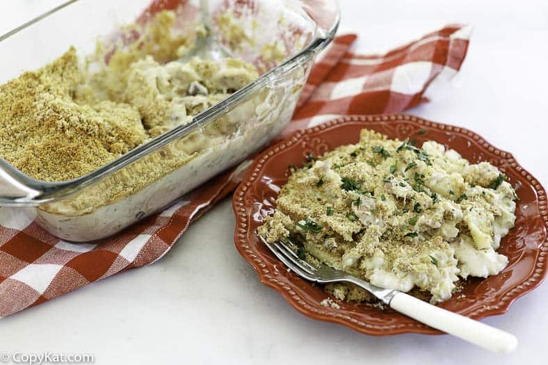 tuna noodle casserole in a baking dish and on a plate