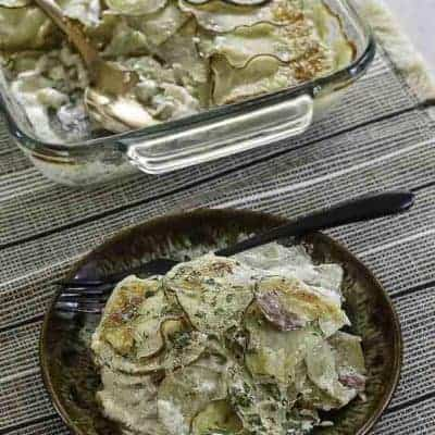a plate of cheesy scalloped potatoes and ham
