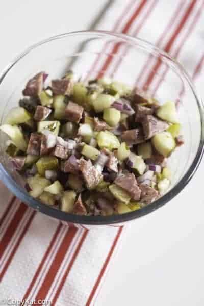 salami salad made with salami, onions, pickles, and olive oil