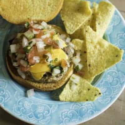 a juicy turkey burger with pico de gallo and cheese