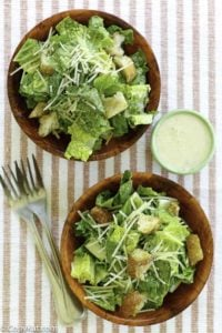 Homemade copycat Outback Steakhouse caesar salad dressing and two small bowls of salad