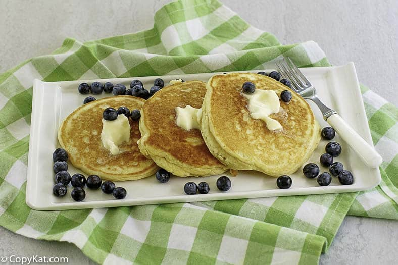 perfectly cooked pancakes with butter and fresh blueberries