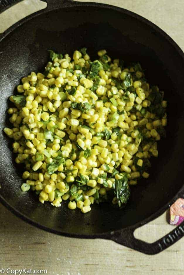 spicy corn salsa in a lblack cast iron bowl
