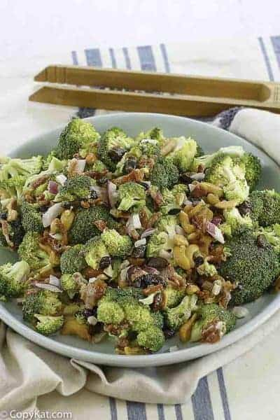broccoli salad with nuts and a sweet dressing in bowl