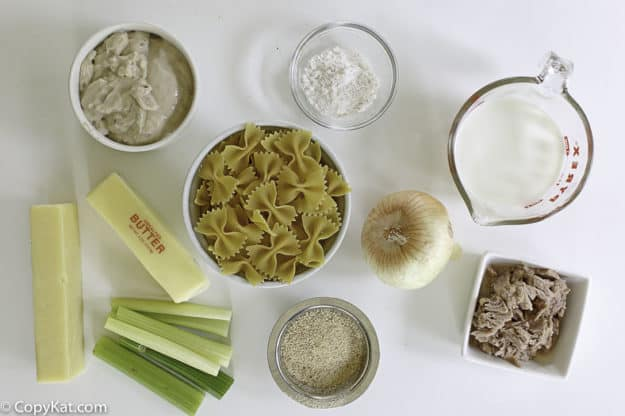 pasta, celery, milk, cream of mushroom soup, and tuna to make tuna casserole