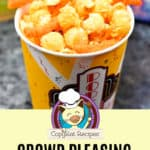 Homemade Cheetos Popcorn in a paper cup.