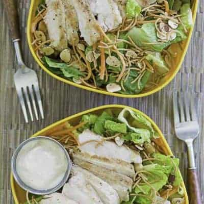 Two bowls of homemade Applebees Grilled Chicken Oriental Salad with Dressing