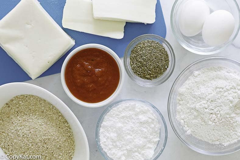 ingredients to make fried mozzarella sticks: mozzarella, bread crumbs, flour, eggs, and more
