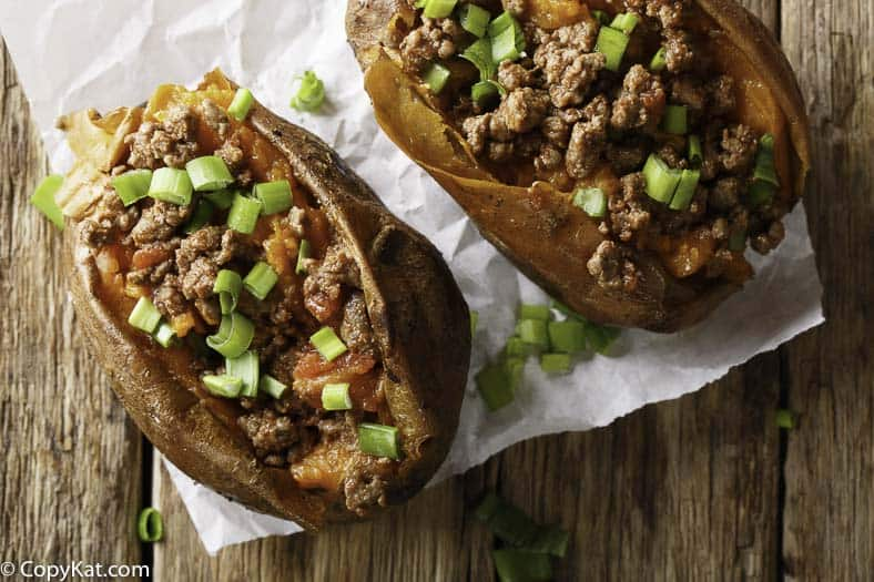 baked sweet potato with ground beef and green onions