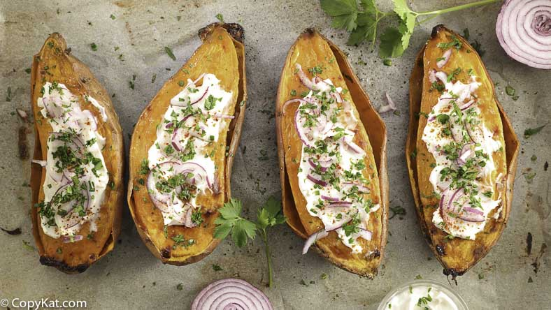 Baked sweet potatoes with sour cream and parsley