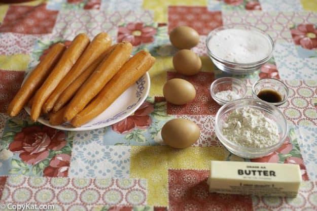raw carrots, eggs, butter, flour, sugar, and vanilla