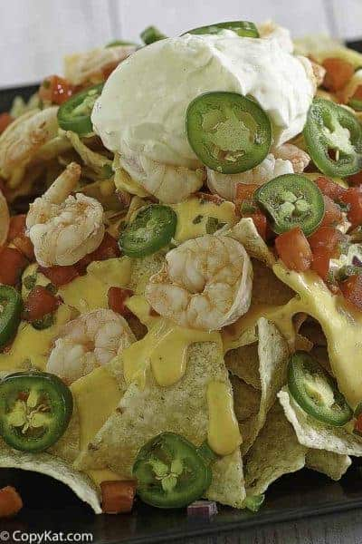 Nachos with cheese, jalapeno peppers, and shrimp