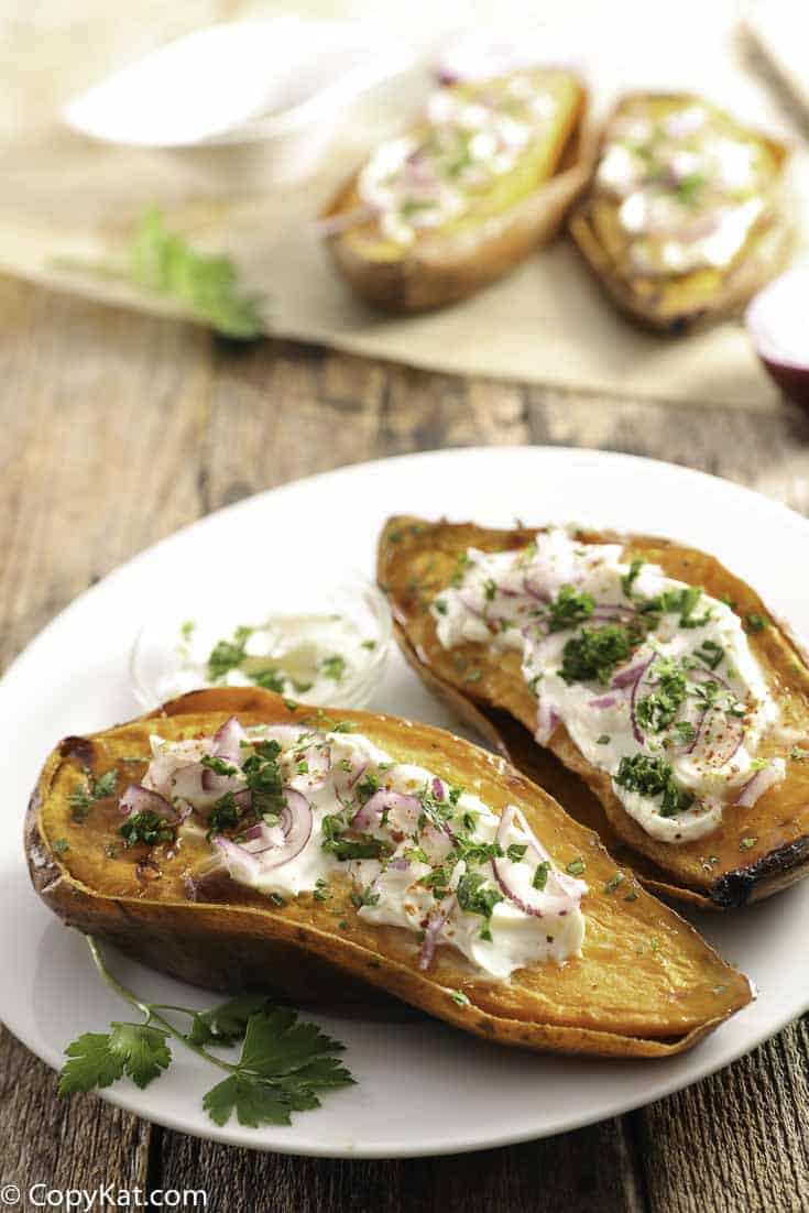 Sweet potatoes topped with sour cream on a plate