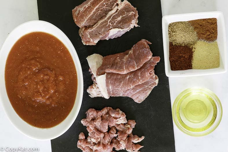 chuck roast, tomato sauces, and spices to make a bowl of chili