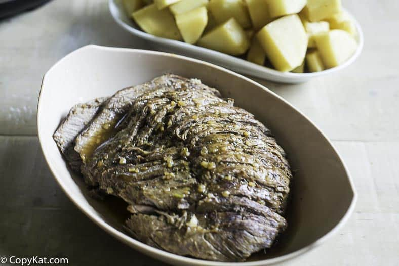 a perfectly tender roast beef cooked with a pressure cooker