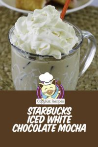 iced white chocolate mocha with whipped cream in a glass