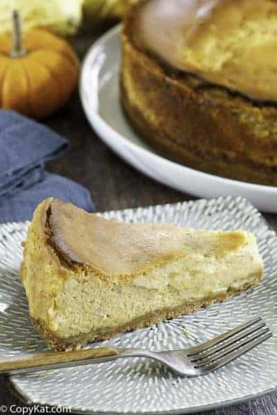a slice if pumpkin cheesecake on a plate