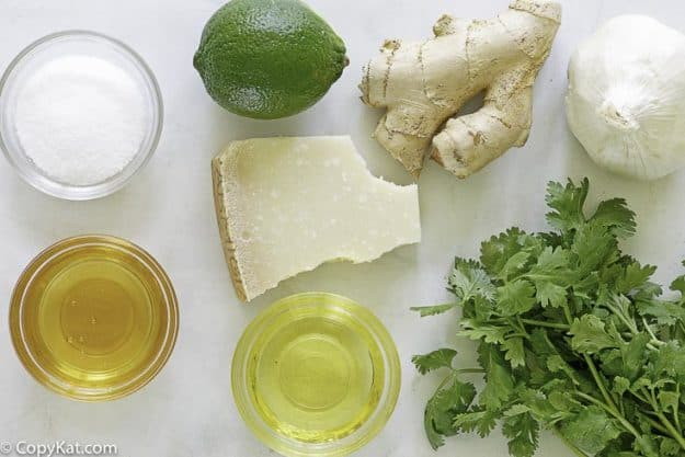 ingredients for homemade salad dressing, lime, cilantro, ginger and more