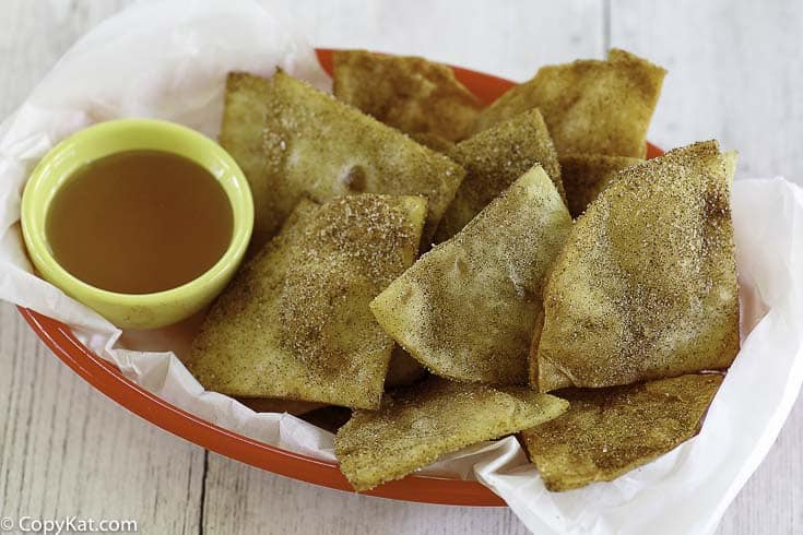 cinnamon sugar tortilla chips and honey in a basket