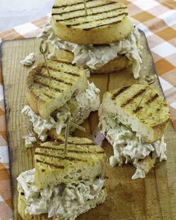two dark meat chicken salad sandwiches made on garlic bred