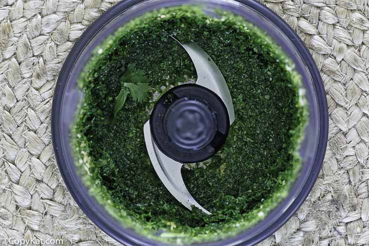 chopped cilantro in a food processor bowl