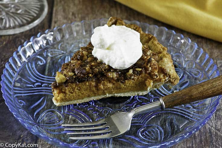 streusel topped pumpkin pie slice on a plate