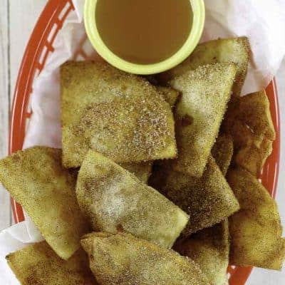 a basket of cinnamon sugar tortilla chips and honey
