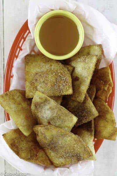 a basket of cinnamon sugar tortilla chips and honey
