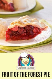 a slice of mixed berry fruit pie on a plate