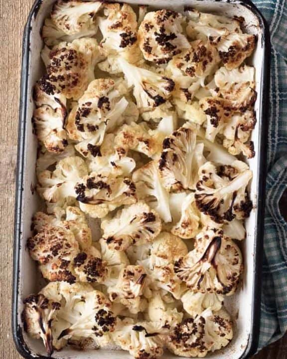 oven roasted cauliflower in a baking dish
