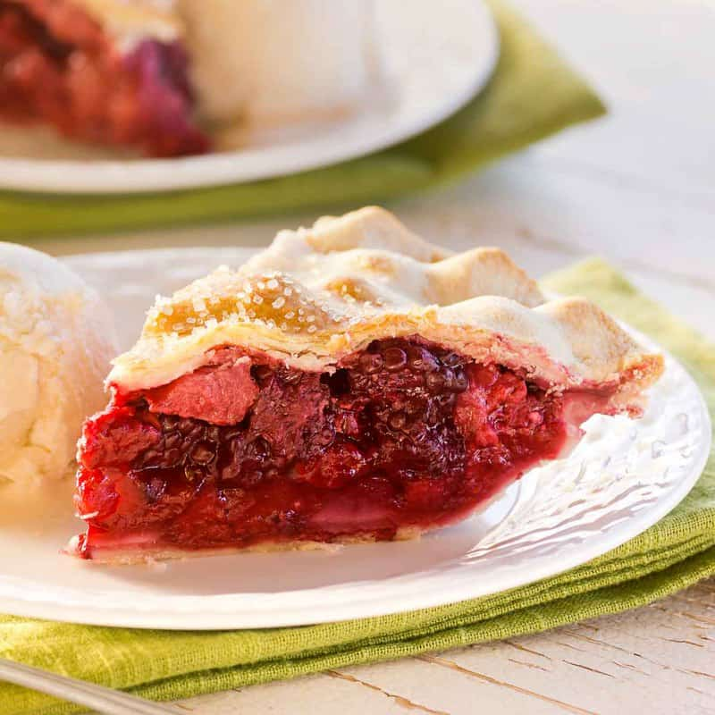 a slice of fruit of the forest pie