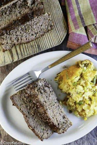 two slices of homemade meatloaf on a plate