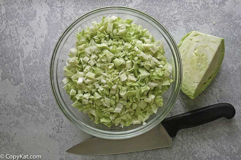 a bowl of cut cabbage