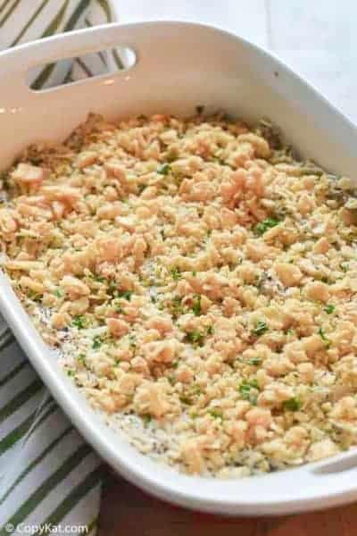 poppy seed chicken casserole in a white baking dish
