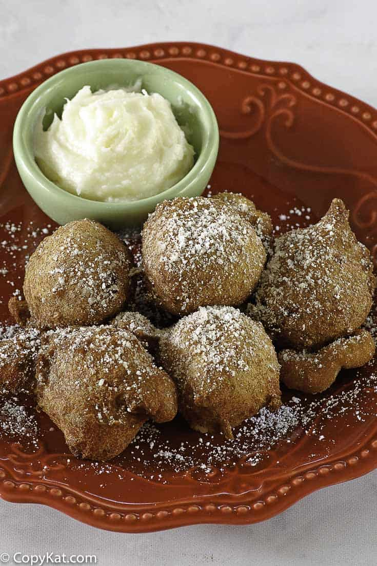Denny's Strawberry Pancake Puppies on a plate with cream cheese dip