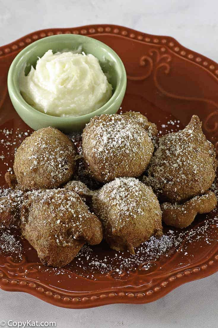Denny's Strawberry Pancake Puppies on a plate with dipping sauce